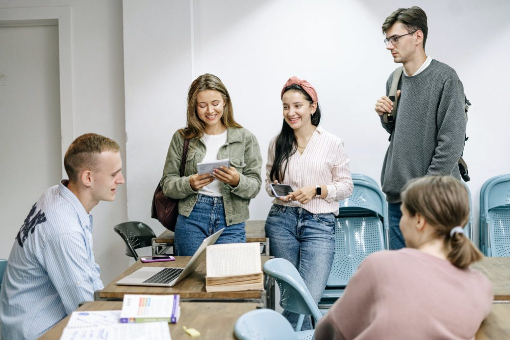 Students talking in a room.